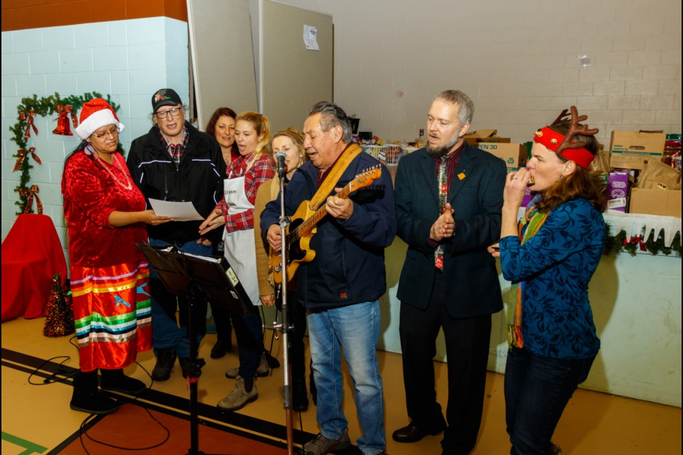 Carollers led by Buddy Wesley holding the guitar sings Christmas songs in Stoney at the second annual Stoney Nativity and Christmas Dinner on Saturday, Dec. 21, 2019 at the old Morley gymnasium. CHELSEA KEMP RMO PHOTO