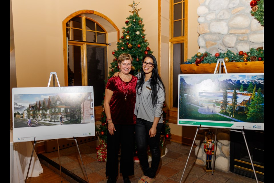 YWCA Banff executive director Connie MacDonald, left, and board chair  Salina Riemer pose with building plans for the organization's proposed Higher Ground development on Wednesday (Dec. 11). CHELSEA KEMP RMO PHOTO