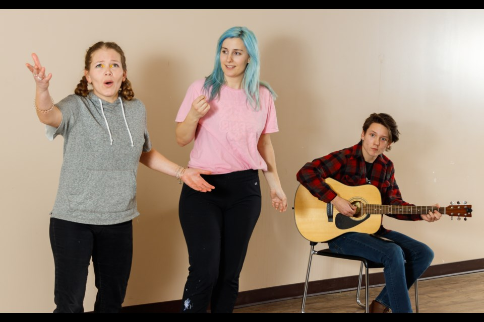 Mountain Alliance Improv members Erin Kerr, left, Rachael Meckling and Liam Brett rehearse for their show the Participation Awards at the Royal Canadian Legion Three Sisters Branch on Friday (Jan. 3). CHELSEA KEMP RMO PHOTO