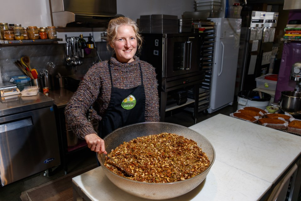 An Edible Life Kitchen owner Carole Beaton stirs oatmeal in her kitchen on Tuesday, Nov. 12, 2019. CHELSEA KEMP RMO PHOTO