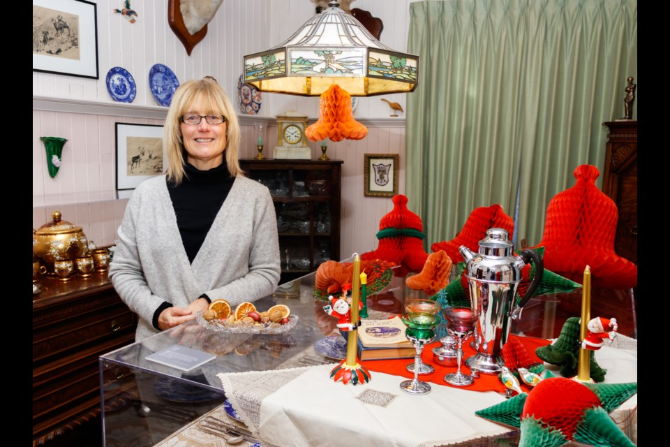 Banff Gallery Hop manager Lynne Huras shows of a selection of vintage Christmas decorations on display at the Luxton Home Museum on Thursday (Nov. 21). CHELSEA KEMP RMO PHOTO