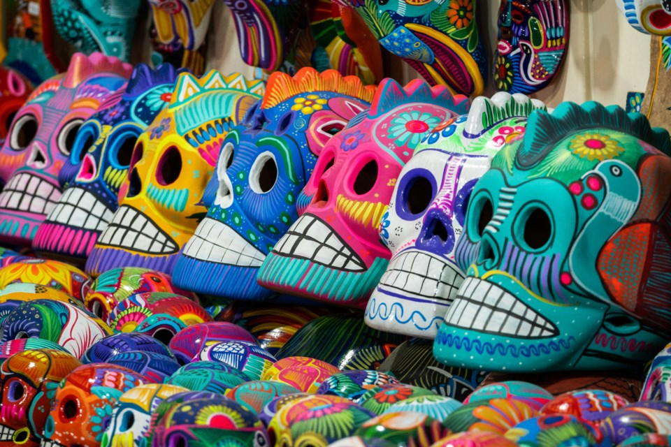 San Miguel de Allende, Mexico - January 13, 2019: Decorated colourful skulls at street market in San Miguel de Allende, Mexico, Day of Dead (Dia de los Muertos) concept.