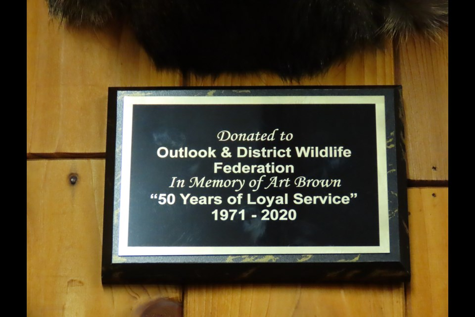 The plaque that now sits underneath the deer in the Outlook clubhouse.