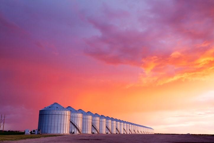 grain bins sunset