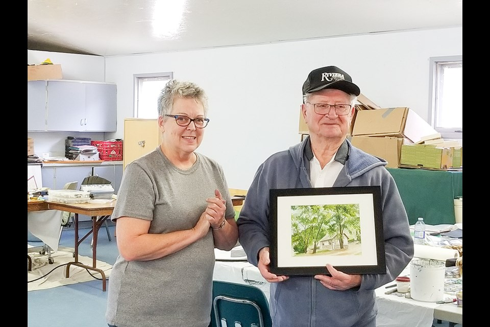 Father Fry with Holly Dauvin, artist of the Art Cabin