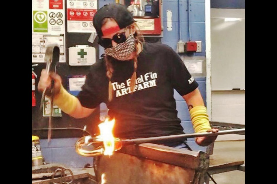 Working with molten glass can be very hot work, says Rickee-Lee Webster, taking her fine arts degree