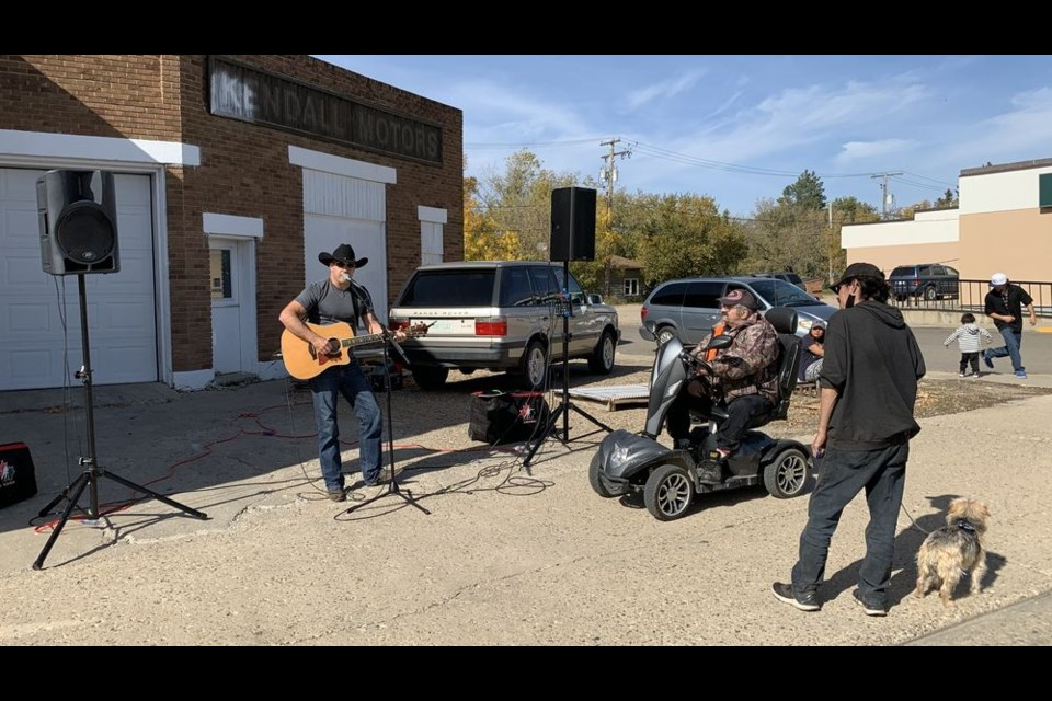Performing on a street corner in Kamsack, Troy MacNaughton of Canora said he was touched by the people he met and the conversations they shared.