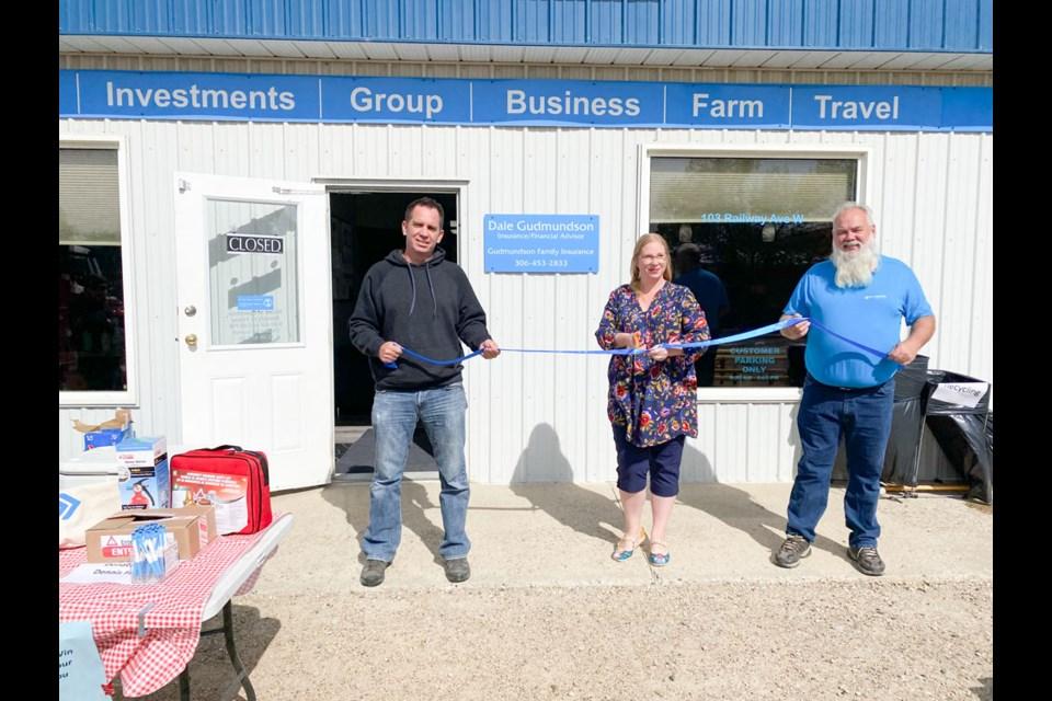 From left, building owner Jared Riddell, Carlyle Mayor Jennifer Sedor and businessman Dale Gudmundson at the grand opening.
