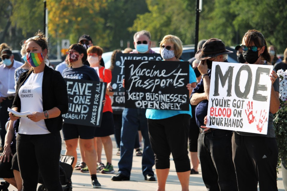 Rally participants gathered in front of the Legislative building in Regina on Thursday calling on action from the provincial government to address COVID-19 in the province.