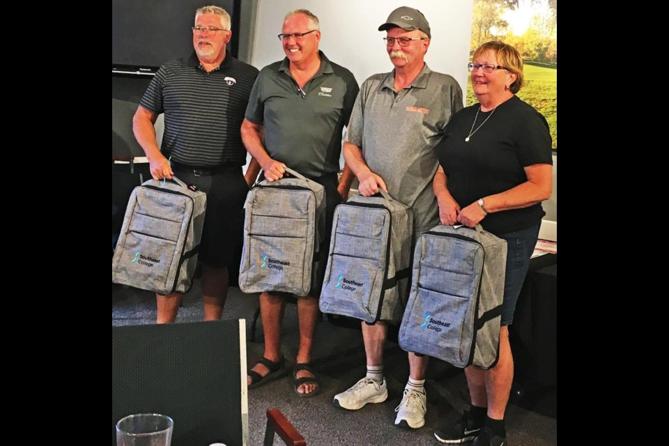 The tournament winners for Southeast College's Swing for Scholarships golf tourney was from Barber Motors, including from left, Russ Chartrand; Jerome Sidloski; Rod Smith, and Cindy Mack.