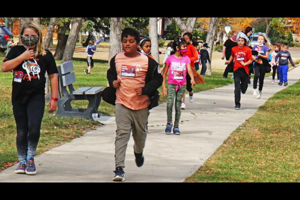 St. Michael School ran, skipped and walked as they took part in the Terry Fox School Run on Wednesday.