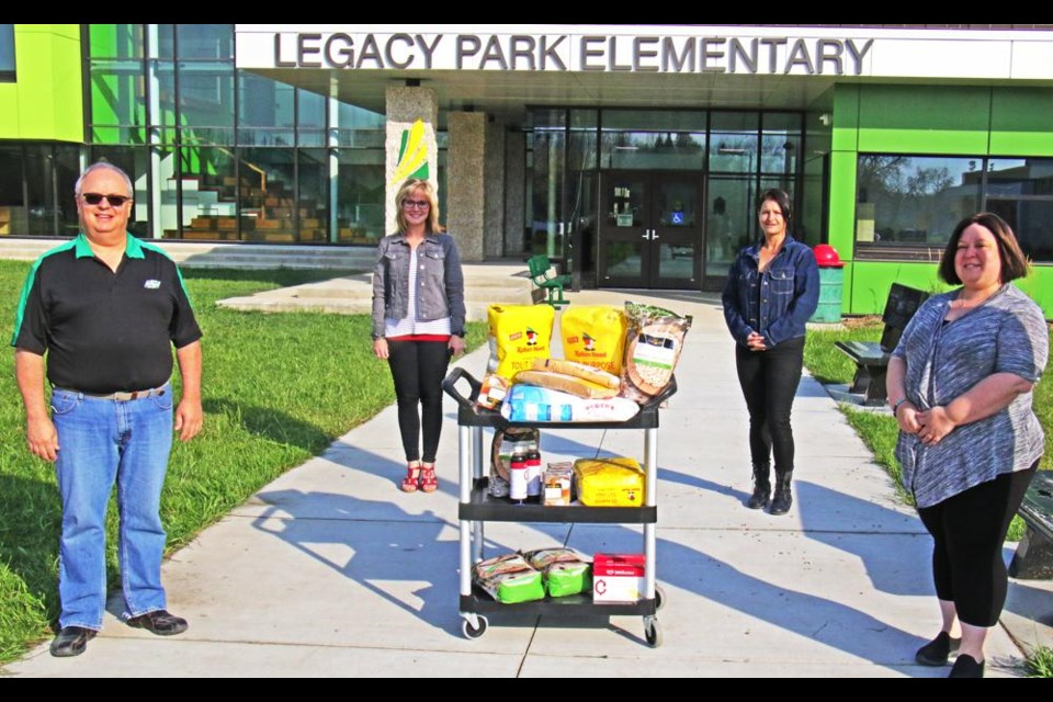 Western Financial representatives brought the ingredients for muffins along with a $1,000 donation to Legacy Park for their nutrition program.