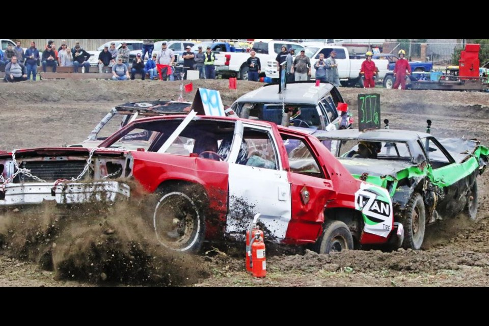 """A car threatens to jump the barrier during the """"Fall Brawl"""" demo derby on Sunday, put on by the Weyburn Ag Society."""