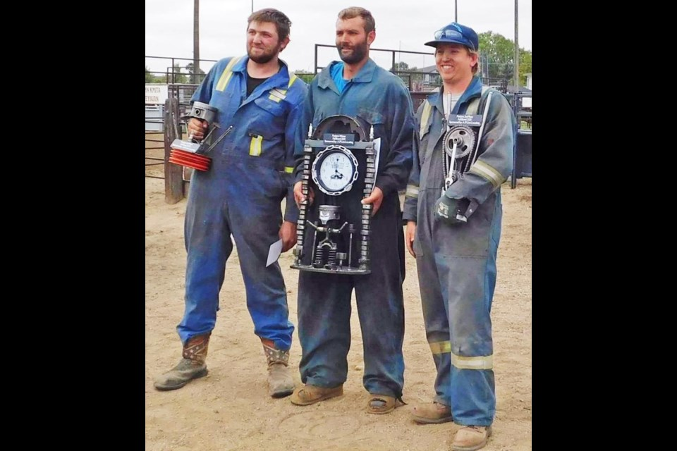 """The overall winners of the """"Fall Brawl"""" demo derby were presented with their trophies on Sunday. From left are Colton Dodd, third place; Jarad Bourassa, first place; and Mac Metheral, second."""
