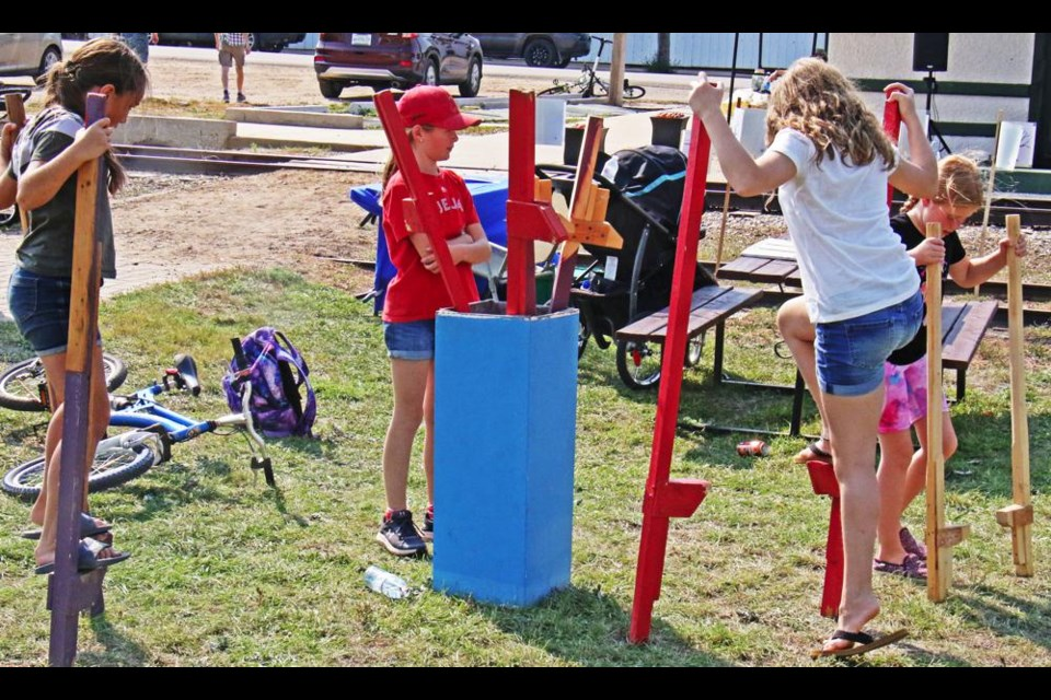 Walking on stilts was one of the old-fashioned activities available for families to try at Radville's Heritage Day on Saturday.