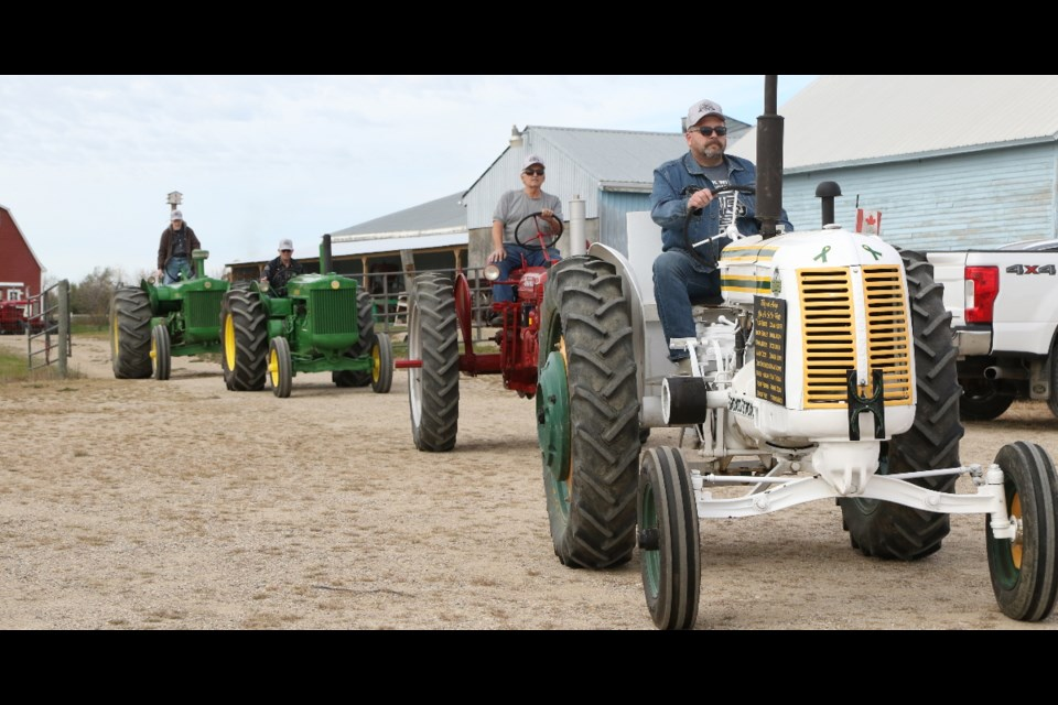 Members of the Humboldt Vintage Club took their vintage tractors for a spin, traveling to Muenster and back.
