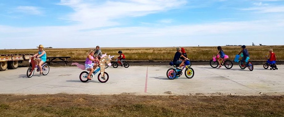 About 20 young riders partook in a bike parade in Macoun.