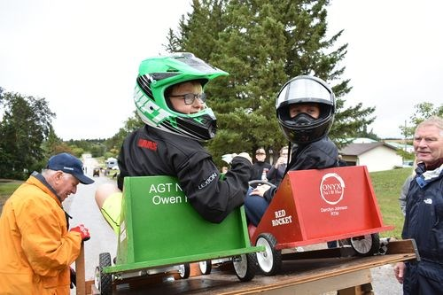 Jake Johnson, left, paired with Liam Kish to see whose box car would be first to cross the finish line at the end of the closed off street in Norquay.