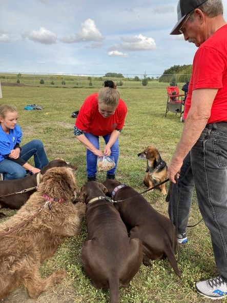 Larry Johnstone, from 4-Diamonds Kennels & Obedience, interacts with attendees at the Paw Park 10th anniversary event Sept. 11.