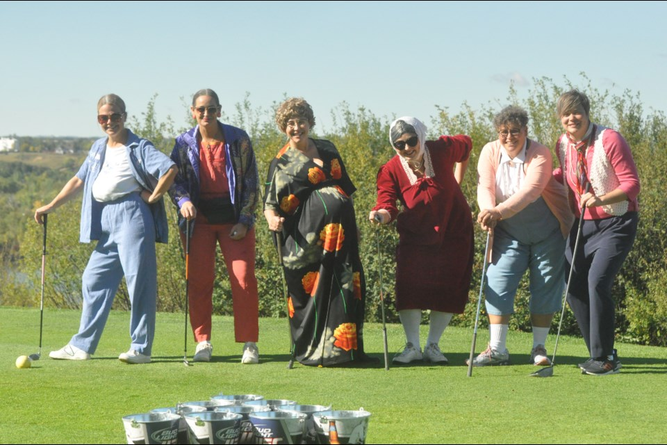 """Seen here on the green are members of the Too Much Muscle team, who won the """"Best Dressed"""" Award at the Wayne Pruden Memorial Golf Tournament: Tracy Voigt, Lori Pruden, Carmen Koehl, Donnica Bernier, Jose Pruden, and Jes Kohut."""