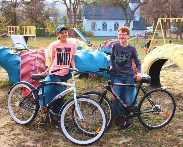 Kye Chase and his friend Ashton Hansen hang out together. Kye is displaying a rescue bike that was given to him by Wes Bloom.