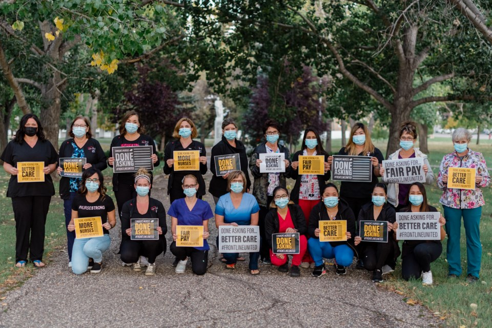 Unity nurses and supportive health care workers stand in solidarity for change.
