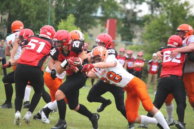 Weyburn Eagles running back Ben Michel (No. 20) sneaks past the defense line of the Yorkton Raiders.