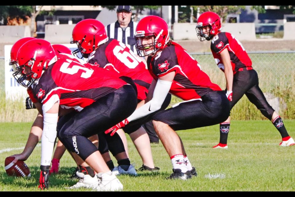 Weyburn Comp Eagles QB Ben Manning yells out the signals on the line, during a controlled scrimmage Friday.