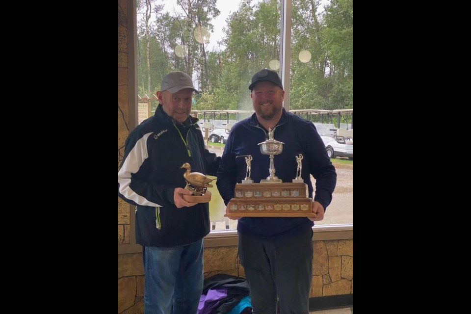 Chris Burton of Yorkton was declared the 2021 Golden Duck Men's Champion. Tournament organizer Rich Patterson, left, presented Burton with the coveted golden duck and winner's trophy.