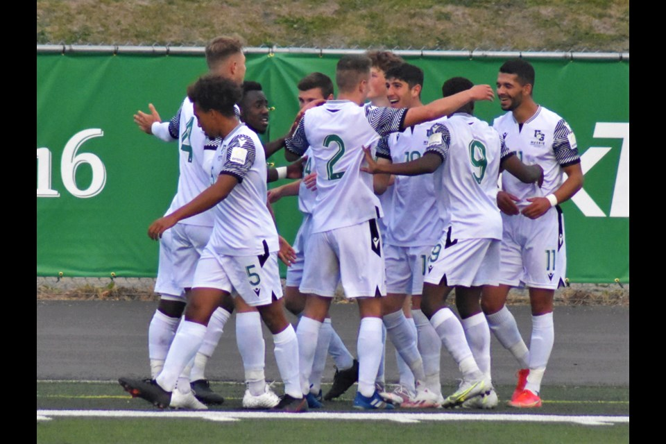 The USask Huskies celebrate one of their four goals against the Lethbridge Pronghorns in their game Friday night at Griffiths Stadium.