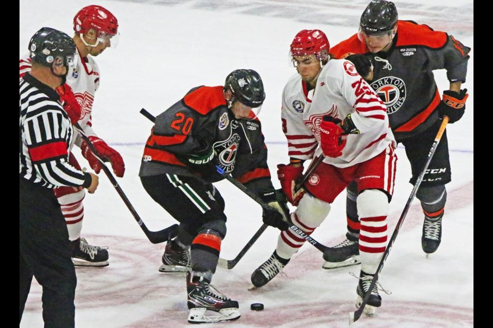 Weyburn Red Wings Shayde Peterson mixed it up at the face-off with Yorkton Terriers players, during the teams' preseason exhibition game on Friday at Crescent Point Place. The Wings were handed a 3-0 loss, their first of the preseason.