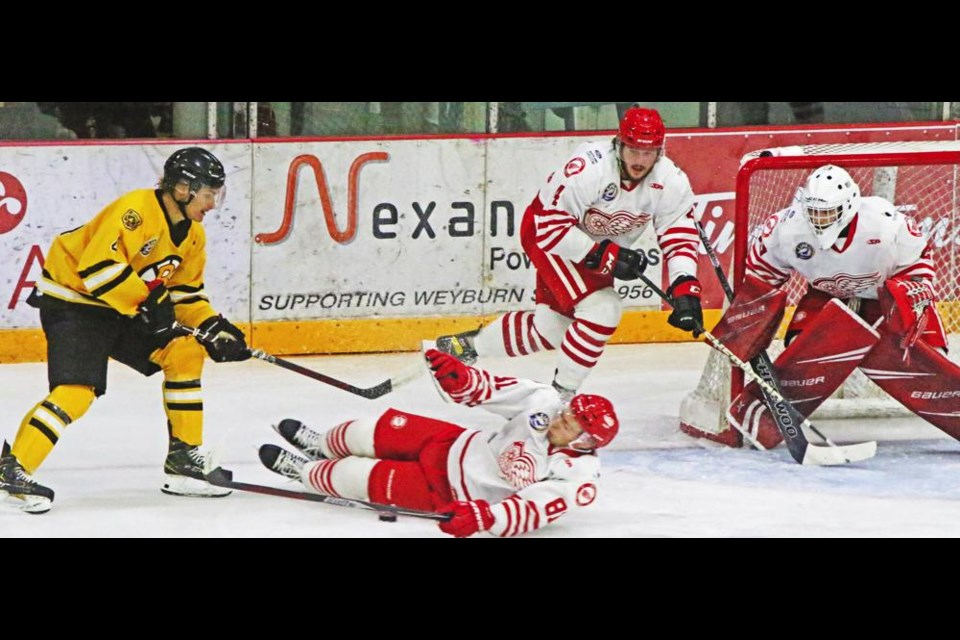 Weyburn Red Wing Brandon Kasdorf laid down in front of an Estevan Bruin, as teammate Cayde Augustin got his stick in front of goaltender Joseph Young, protecting the Wings from being scored on in an exhibition game on Sunday afternoon.