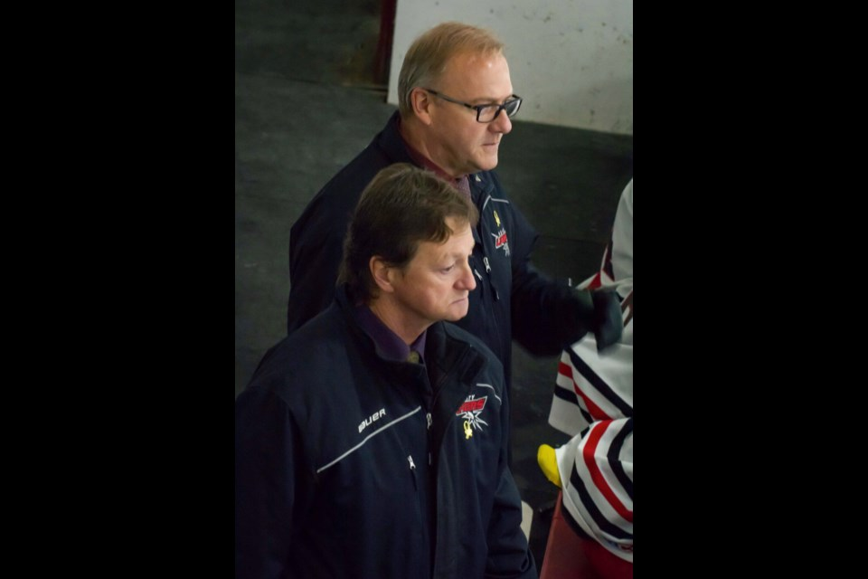 Long time Midget AA hockey coaches, Stan Weber and Dwayne Scott, have called it a career after more than 25 years coaching