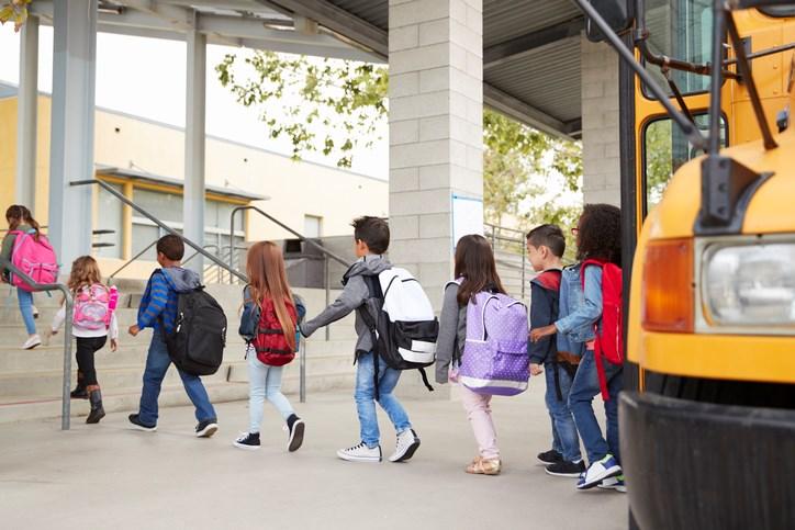 Kids walking to the bus