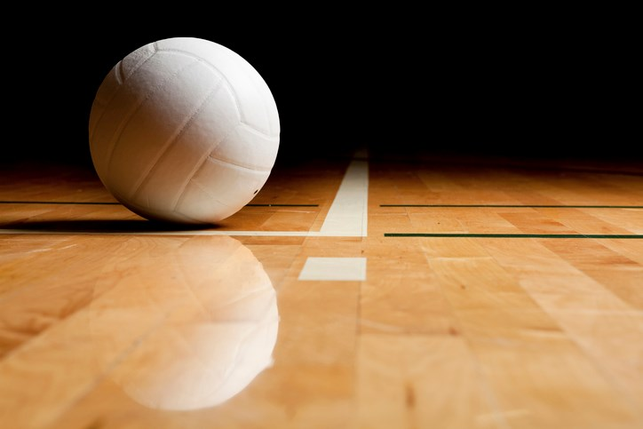 volleyball and reflection on a wooden floor