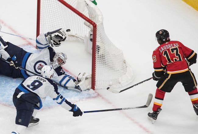 Flames Ground Jets 4 1 To Take Series Lead Winnipeg S Scheifele Injured Pique Newsmagazine