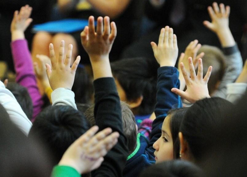 kids-raised-hands