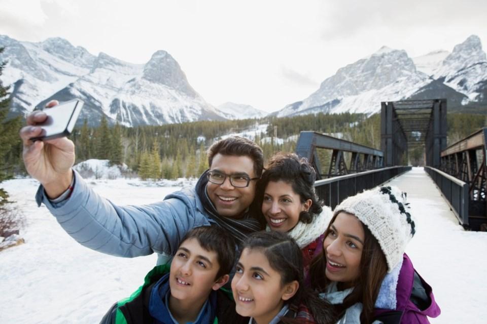 family-selfie-mountains-outside
