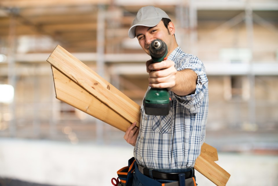 cordless drill man stock