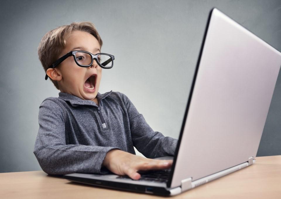 kid typing surprised stock