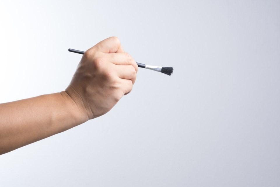 paintbrush hand stock