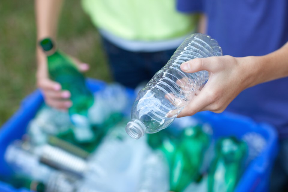 The Living and Learning Green program is a partnership between the county and the school boards to run recycling and organics collection at all local schools. Stock image
