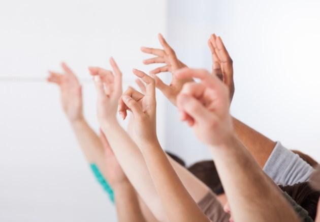 show of hands AdobeStock_63758659