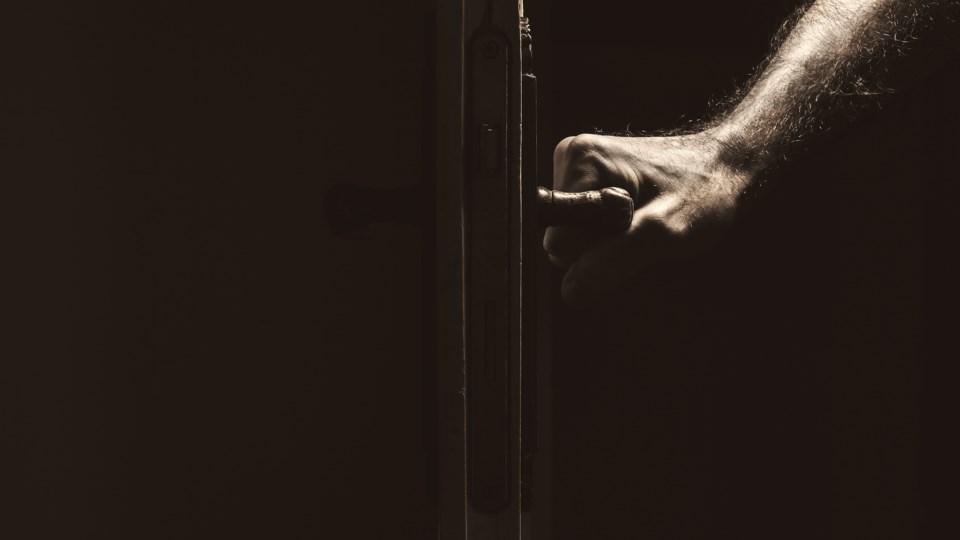 stranger door hand
