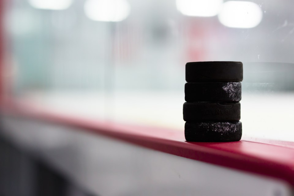 hockey pucks AdobeStock_123980890
