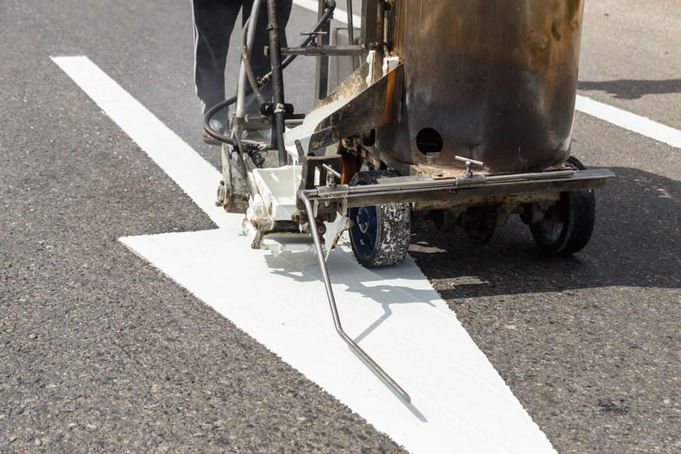 road line painting AdobeStock