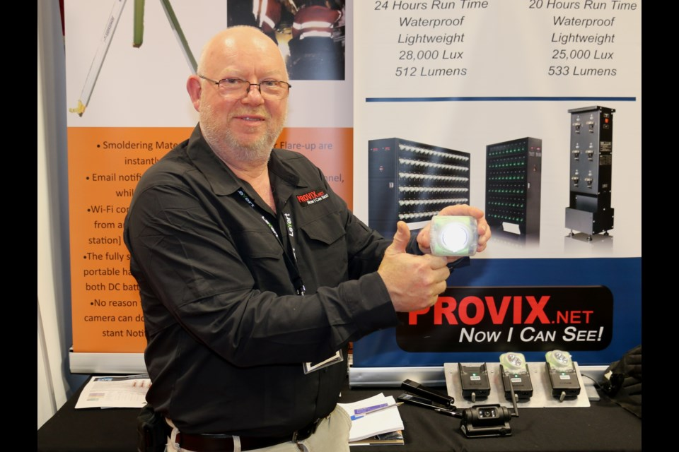 Dave Winfield of Provix Inc. showing off the new self-contained cordless Wisdom cap lamp that features long-lasting lithium ion batteries. Winfield was at the Big Event Mine Expo held in Timmins in June.  LEN GILLIS / SMSJ 2019