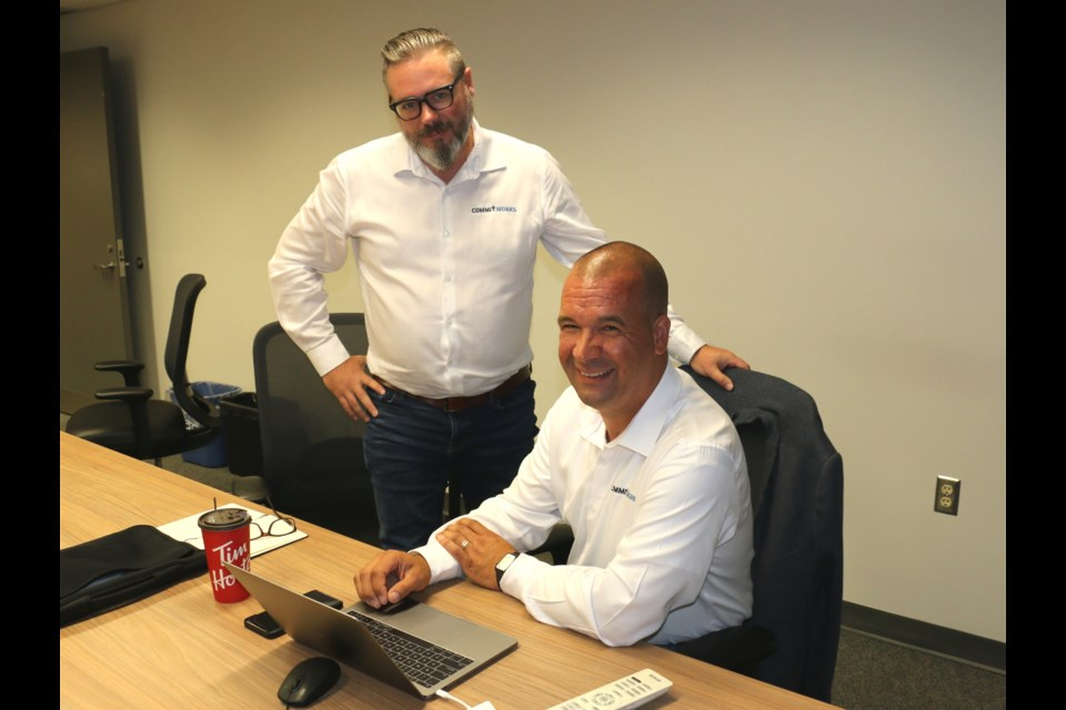 The first two North American based employees of Commit Works are on the job in Sudbury.  Derek Polano, left, adoption and results manager works with Joe Gladu, VP for North America.  LEN GILLIS / SMSJ 2019
