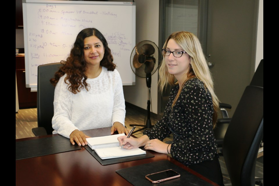 Planning is now underway for the third annual Beyond Digital Transformation conference to be held in Sudbury in February. PACE CEO Neha Singh (left) recently discussed details of the conference with Lindsay Lane, communications coordinator at NORCAT, which is one of the event partners. (Len Gillis/Sudbury Mining Solutions Journal)