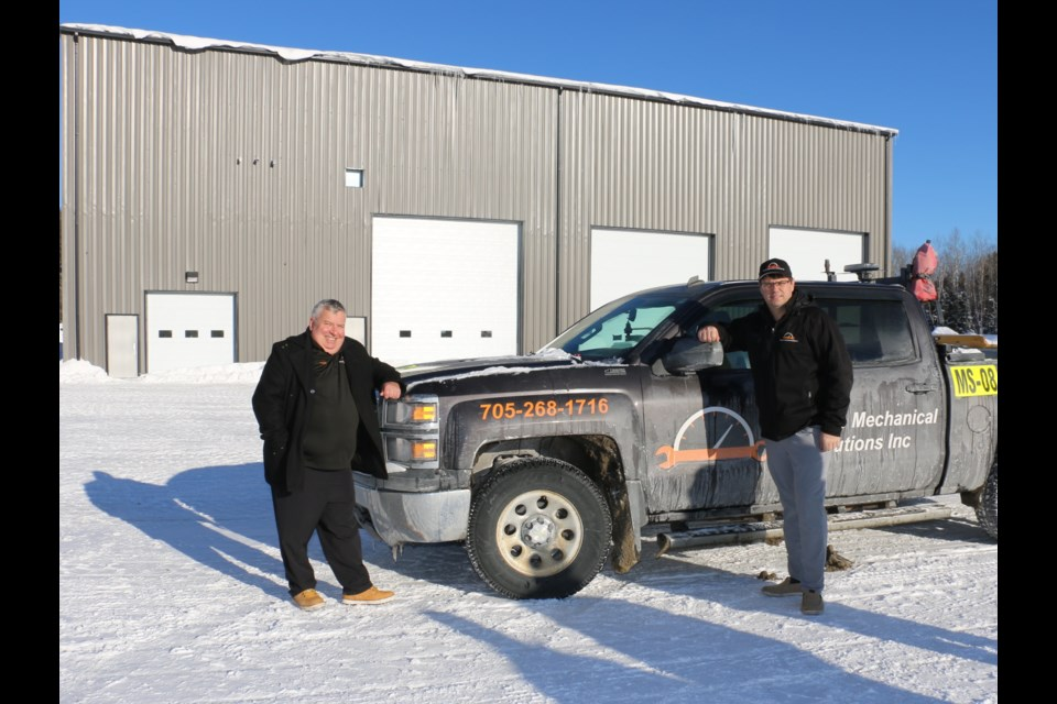 TMS Sales Director Eddy Lamontagne, left, and TMS president Chad Tolonen were pleased to show off the company's new 12,000-square foot shop in the west end of Timmins earlier this winter.  The company is working the meet the demand for high level heavy equipment technicians in the mining industry.